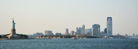 Panoramic image of lower Manhattan skyline. From Staten Island Ferry boat, New York City Royalty Free Stock Images