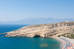 Panoramic image of Matala caves and Matala beach on the Crete island, Greece. Royalty Free Stock Image