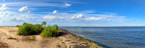 Panoramic image of a mouth of Swina river in Swinoujscie, Poland Royalty Free Stock Images