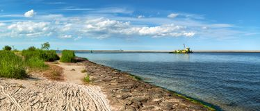 Panoramic image of a mouth of Swina river in Swinoujscie, Poland. Panoramic image of a mouth of Swina river in Swinoujscie, a port in Poland on the Baltic Sea Royalty Free Stock Images