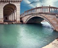 Panoramic image of Paglia  bridge and arches of Prigioni Palace. Panoramic image of Paglia  bridge, or Ponte dela Paglia, and arches of Prigioni Palace in Venice Stock Photo
