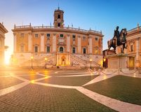 Panoramic image of Piazza del Campidoglio on Capitoline Hill on. Panoramic image of Piazza del Campidoglio on Capitoline Hill with Palazzo Senatorio and statue Royalty Free Stock Images