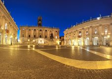 Panoramic image of Piazza del Campidoglio on Capitoline Hill in. Panoramic image of Piazza del Campidoglio on Capitoline Hill with Palazzo Senatorio and statue Stock Image