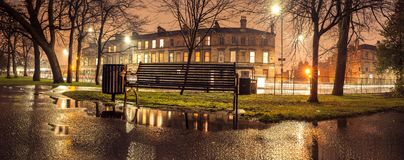 Panoramic image of Queens Park in Glasgow at night. In Scotland city sunset sky warm twilight old history bench pond water street royalty free stock photography