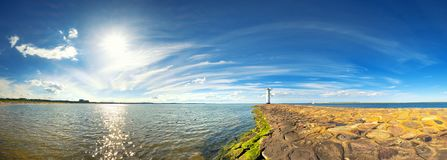 Panoramic image of a seaside by lighthouse in Swinoujscie, Polan Royalty Free Stock Photography