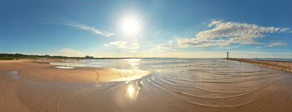 Panoramic image of a seaside by lighthouse in Swinoujscie, Polan Royalty Free Stock Image