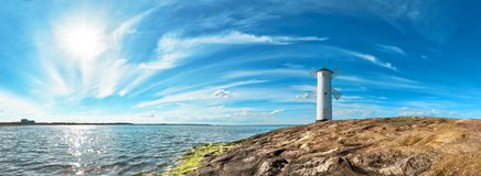 Panoramic image of a seaside by lighthouse in Swinoujscie, Polan. Panoramic image of a seaside by lighthouse in Swinoujscie, a port in Poland on the Baltic Sea Royalty Free Stock Image