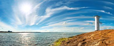 Panoramic image of a seaside by lighthouse in Swinoujscie, Polan Royalty Free Stock Images