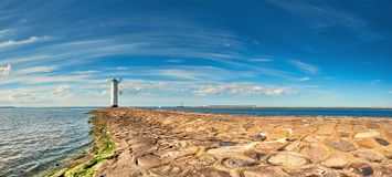 Panoramic image of a seaside by lighthouse in Swinoujscie, Polan. Panoramic image of a seaside by lighthouse in Swinoujscie, a port in Poland on the Baltic Sea Royalty Free Stock Images