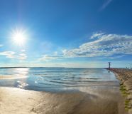 Panoramic image of a seaside by lighthouse in Swinoujscie, Polan. Panoramic image of a seaside by lighthouse in Swinoujscie, a port in Poland on the Baltic Sea Stock Images