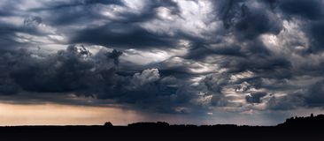 Panoramic image of storm clouds with asperitas clouds. In Lithuania stock images