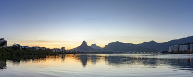 Panoramic image of the sunset at Lagoa Rodrigo de Freitas. In Rio de Janeiro with its mountains, buildings and characteristic outline Stock Photos