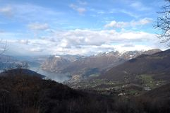 Panoramic image of Valcamonica with Lake Iseo and in the backgro. Und the snow-capped mountains - Brescia - Lombardy - Italy 12 Royalty Free Stock Images