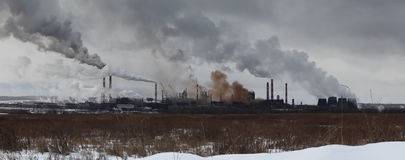 Panoramic image of winter landscape with industrial plant Stock Photos