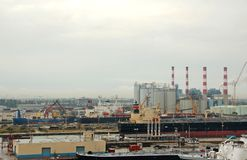 Panoramic industrial view of port and refining operations Stock Images