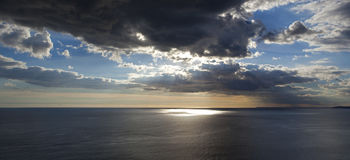 Panoramic inspirational sunset over the ocean. Stock Image