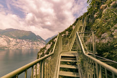 Panoramic iron staircase on Lake Garda. Along the trail from Busatte to Tempesta near the town of Torbole Stock Image