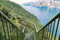 Panoramic iron staircase on Lake Garda. Along the trail from Busatte to Tempesta near the town of Torbole Stock Photos