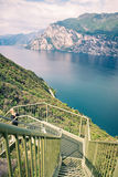 Panoramic iron staircase on Lake Garda. Along the trail from Busatte to Tempesta near the town of Torbole Royalty Free Stock Photos