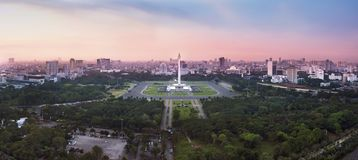 Panoramic Jakarta skyline with iconic symbol likes National Monument Monas in the afternoon. Jakarta, Indonesia stock photo