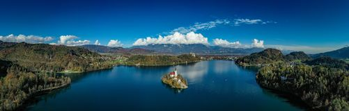 The Panoramic Lake Bled. A multi shot stiched panoramic drone shot of Lake Bled in Slovenia. Amazing weather conditions helped with this shot. Shot with a DJI stock photography