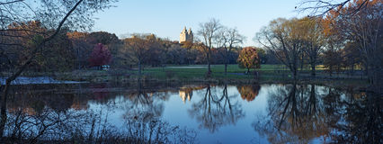 Panoramic lake with reflections, Central Park Autumn, New York. Panoramic view of the lake with reflections, background Trees, Central Park Autumn, New York Royalty Free Stock Images