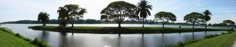 Panoramic Lake View. Panoramic view of Lake Taylor, Florida with trees on a land strip royalty free stock photo