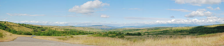 Panoramic landscape. In the way to the mountains Stock Photo