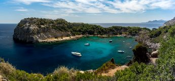 Beach of Anthony Quinn Bay on Rhodes island Royalty Free Stock Photo