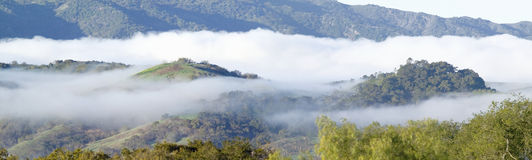 Panoramic landscape with clouds over green spring hills of Southern California, Ventura County, Oak View, CA Royalty Free Stock Photography