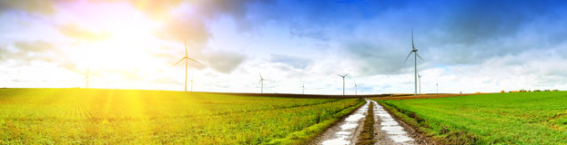 Panoramic landscape with country road. And wind turbines Royalty Free Stock Photos