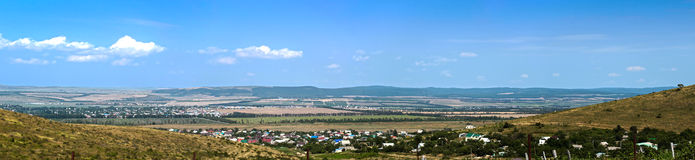 Panoramic landscape countryside in the valley. Panoramic view of village located in the valley Royalty Free Stock Image