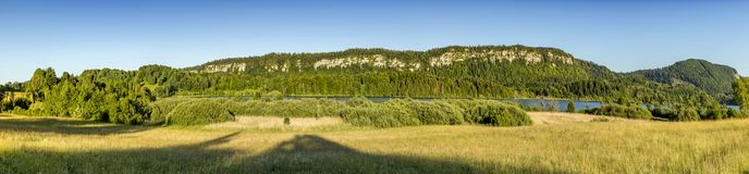 Panoramic landscape in french Jura region at Le Frasnois. Under blue sky stock photos