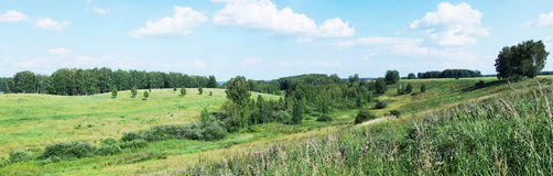 Panoramic landscape with green valley and sunny blue sky Royalty Free Stock Photo