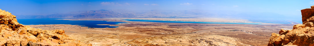 Panoramic landscape of Judaean Desert and Dead Sea. Panoramic lanscape of the Judaean Desert and Dead Sea. View from Massada Fortress Royalty Free Stock Image