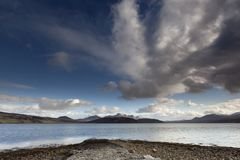 Panoramic landscape at the kyle. This beautiful panoramic landscape is near Tongue in Scotland pictured from the shore at the kyle with Ben Loyal mountain to the royalty free stock photo