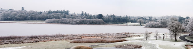 Panoramic landscape lake with castle in dista Royalty Free Stock Photography