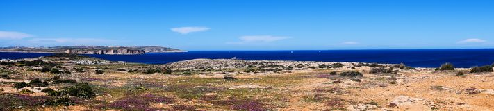 Panoramic Landscape of Malta. A panoramic landscape of the countryside in Mellieha, Malta with a view on Comino and Gozo Royalty Free Stock Photography