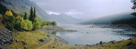 Panoramic landscape of misty lake with autumn foliage. While traveling through Canada royalty free stock image