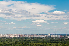 Panoramic landscape of modern developing metropolis with parks and lots of construction Royalty Free Stock Photos
