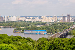Panoramic landscape of modern developing metropolis with river a Royalty Free Stock Image