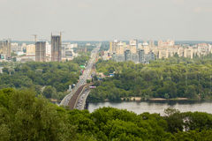 Panoramic landscape of modern developing metropolis with river, bridge, subway, parks and lots of construction Stock Photo