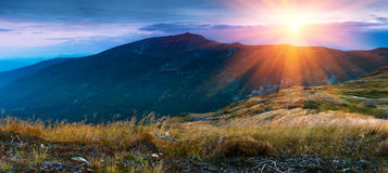 Panoramic landscape in the mountains at sunrise. Royalty Free Stock Photography