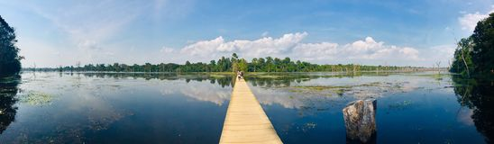 Panoramic landscape at Neak Pean wooden bridge in Siem Reap Cambodia royalty free stock image