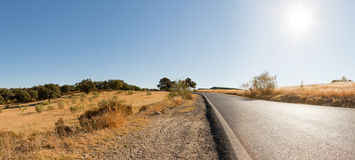 Panoramic landscape photo of mountains with road. Royalty Free Stock Photo