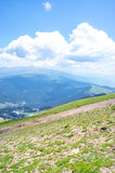 Panoramic landscape of the Pyrenees mountains and fluffy clouds Royalty Free Stock Photos