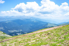 Panoramic landscape of the Pyrenees mountains and fluffy clouds Royalty Free Stock Image