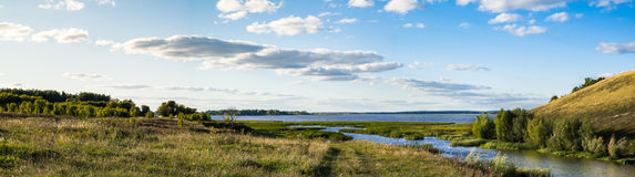 Panoramic Landscape. With river, meadow, sky Royalty Free Stock Photography
