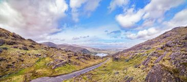 Panoramic landscape with a road to the Glanmore lake. Freshwater lake in the southwest of Ireland. It is located on the Beara Peninsula in County Kerry royalty free stock images