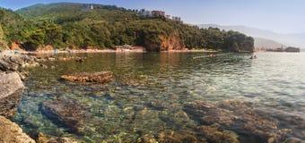 Panoramic landscape of the rocky coastline sea and Mogren Beach at summertime. Budva, Montenegro. Stock Photos